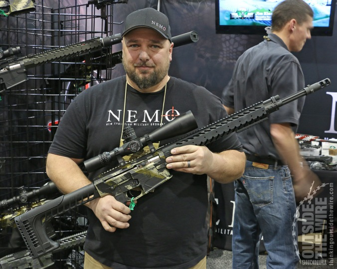 Buck Hume displays a Nemo Omen rifle. Chambered in .300 WM with an internal recoil-reducing system, the Omen features a well-designed handguard, rubberized grip, and SSR-25 Sniper Stock. The rifle also shows off Nemo's attractive and functional finish.